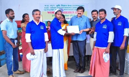 Launching of Aqua task force-Dr.A Gopalakrishnan, Director CMFRI handing over certificate to the group.JPG