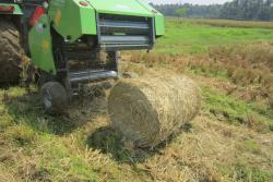 Paddy-straw-bailing-machine-demonstrated-by-KVK-at-Manakkapadam,-near-Kanjoor,-Kalady