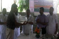 Shri.T.U.Kuruvila MLA selling the first lot of carp seeds produced by KVK in PPP mode.